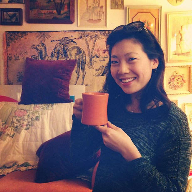 Cindy Chu Enjoying a mug of coffee at Zenith Antiques in Shadyside, Pittsburgh